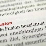 Fusión Empresarial en España: fusión por creación o fusión por absorción